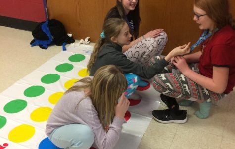 A WEB leader and sixth graders playing Twister