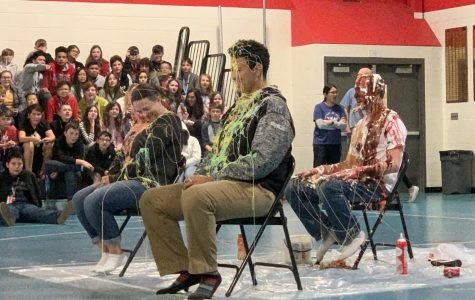 The principals get covered in various materials at the Children's Hospital Pennies for Patients fundraiser.